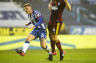 Wigan's Max Power (6) shoots during the EFL Sky Bet Championship match between Wigan Athletic and Ipswich Town at the DW Stadium, Wigan, England on 17 December 2016. Photo by Craig Galloway.