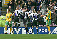 Photo. Andrew Unwin.<br /> Newcastle United v Norwich, Barclays Premiership, St James Park, Newcastle upon Tyne 25/08/2004.<br /> Newcastle's Aaron Hughes (C) celebrates scoring his team's second goal with Nicky Butt (L) and Craig Bellamy (R)