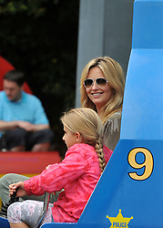 © licensed to London News Pictures. WINDSOR, UK.  09/07/11. Penny lancaster and her niece Raphella (pink coat) on the 'Chopper Squadron' ride.  Penny Lancaster and her family at Legoland Windsor, today 09 July 2011. Penny Lancaster is married to Rod Stewart.  PERMISSION GRANTED BY PENNY LANCASTER FOR CHILDREN TO BE IDENTIFIED. Mandatory Credit Stephen Simpson/LNP