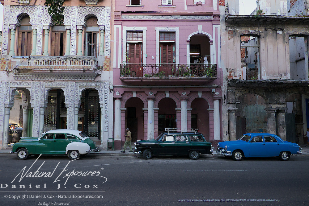 Old vintage cars on the Paseo del Prado that separates old and new Havana, Cuba.