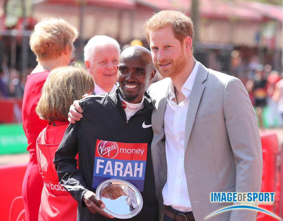Prince Harry (right) poses with Mo Farah aka Mohamed Farah (GBR) after Farah  placed  third in 2:06:21 in the London Marathon in London, Sunday, April 22, 2018. (Jiro Mochizuki/Image of Sport)