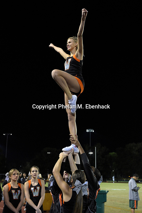 The Winter Park cheerleaders perform before a high school football game against Dr. Phillips in Winter Park, Fla., Friday, Nov. 7, 2014. (Photo by Phelan M. Ebenhack)