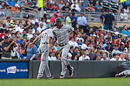 Alejandro De Aza #30 of the Chicago White Sox is congratulated by 3rd base coach Joe McEwing #47 after hitting a home run against the Minnesota Twins on June 19, 2013 at Target Field in Minneapolis, Minnesota.  The Twins defeated the White Sox 7 to 4.  Photo: Ben Krause