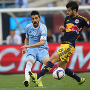 David Villa, (left), NYCFC, is challenged by Felipe Martins, New York Red Bulls, during the New York City FC Vs New York Red Bulls, MSL regular season football match at Yankee Stadium, The Bronx, New York,  USA. 28th June 2015. Photo Tim Clayton