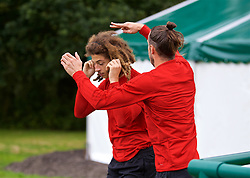 CARDIFF, WALES - Tuesday, September 4, 2018: Wales' Gareth Bale pretends to cut the hair of Ethan Ampadu during a training session at the Vale Resort ahead of the UEFA Nations League Group Stage League B Group 4 match between Wales and Republic of Ireland. (Pic by David Rawcliffe/Propaganda)