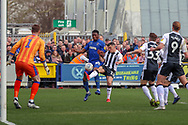 AFC Wimbledon defender Paul Kalambayi (30) battles for possession with Gillingham midfielder Callum Reilly (13) during the EFL Sky Bet League 1 match between AFC Wimbledon and Gillingham at the Cherry Red Records Stadium, Kingston, England on 23 March 2019.