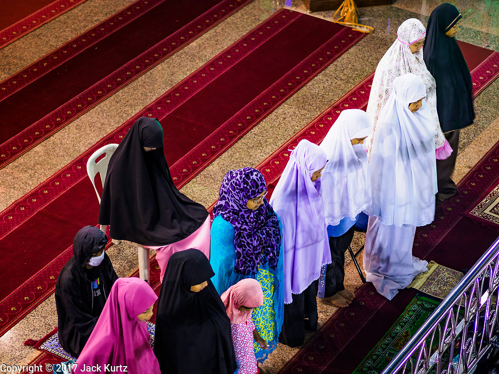 14 JUNE 2017 - BANGKOK, THAILAND: Women pray before Iftar at Masjid Hidayatun Islam. Iftar is the evening meal when Muslims end their daily Ramadan fast at sunset. Iftar is a communal event at Masjid Hidayatun Islam and more than a hundred people usually attend the meal.      PHOTO BY JACK KURTZ