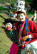 Asian and white 4-H clowns age 17 performing at State Fair.  St Paul Minnesota USA