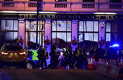 """Police Officers outside the Barrowboy and Banker Public House on Borough High Street as police are dealing with a """"major incident"""" at London Bridge."""