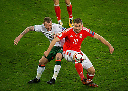 CARDIFF, WALES - Monday, October 9, 2017: Wales' Sam Vokes in action with Republic of Ireland Glenn Whelan during the 2018 FIFA World Cup Qualifying Group D match between Wales and Republic of Ireland at the Cardiff City Stadium. (Pic by Peter Powell/Propaganda)