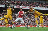 Football - 2017 / 2018 Premier League - Arsenal vs. Brighton & Hove Albion<br /> <br /> Shane Duffy and Lewis Dunk of Brighton foil Aaron Ramsey of Arsenal at The Emirates.<br /> <br /> COLORSPORT/ANDREW COWIE