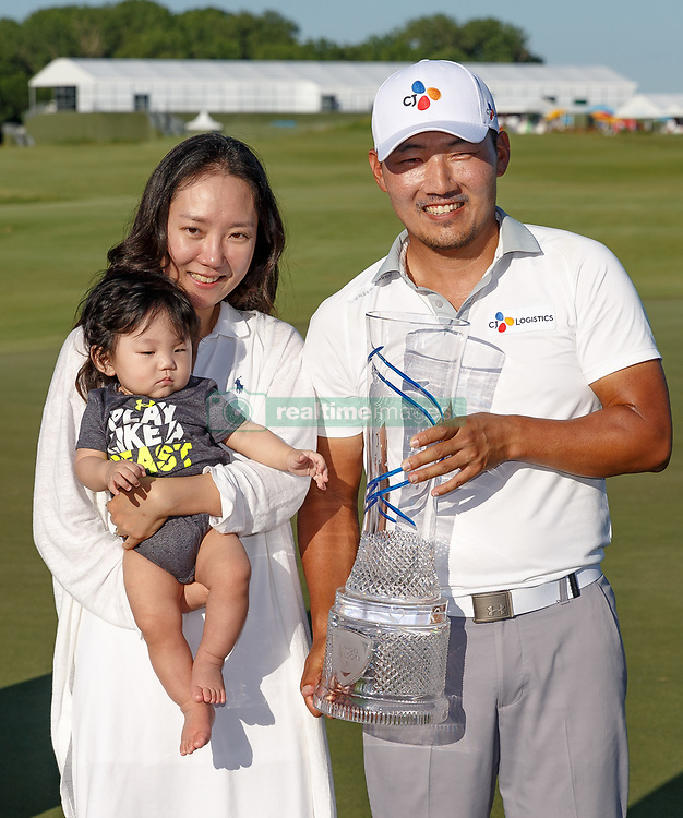 May 12, 2019 - Dallas, TX, U.S. - DALLAS, TX - MAY 12: Sung Kang poses with his wife and child and the winner's trophy after winning the AT&T Byron Nelson on May 12, 2019 at Trinity Forest Golf Club in Dallas, TX. (Photo by Andrew Dieb/Icon Sportswire) (Credit Image: © Andrew Dieb/Icon SMI via ZUMA Press)