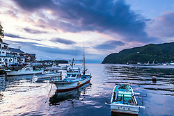 Heda Port at sunset. Heda Port is a fishing harbor a couple of hours south of Tokyo Japan. I find it interesting that the fishing boats of Japan are styled so much different than the fishing boats of the USA. I wonder if it merely style or function.