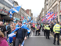 All Under One Banner March For Independence, Glasgow, Saturday 5th May 2018<br /> <br /> Thousands of people joined a march in support of Scottish Independence today in Glasgow.<br /> <br /> There were flags of many countries represented.<br /> <br /> Marchers make their way down Union Street which may be looking for a change of name if Scots vote for independence. A small group of protesters appeared waving union flags but the police were on hand to make sure they didn't disrupt the peaceful march.<br /> <br /> Alex Todd | EEm