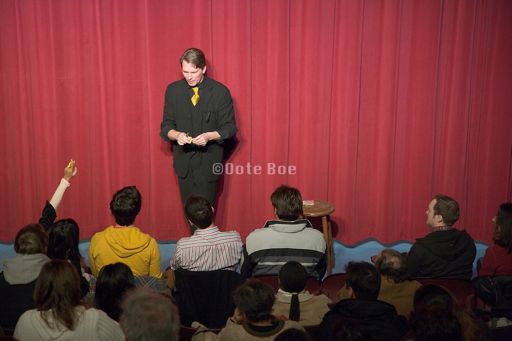 magician performing a magic trick on stage