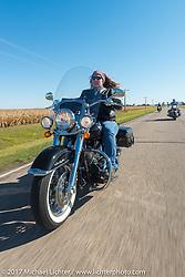 Michaela Glugla of Aberdeen, SD riding her Harley-Davidson Softail Deluxe in the USS South Dakota submarine flag relay near Groton as it crosses South Dakota. USA. Sunday October 8, 2017. Photography ©2017 Michael Lichter.
