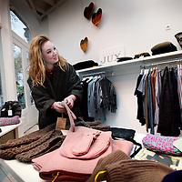 Nederland, Amsterdam , 22 november 2013.<br /> Pop up store met duurzame kleding uit Nepal aan de Nieuwezijds Voorburgwal.<br /> Op de raam staat geschreven: My tailor is a rockstar.<br /> Foto:Jean-Pierre Jans