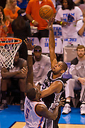 June 2, 2012; Oklahoma City, OK, USA; San Antonio Spurs forward Tim Duncan (21) takes a shot over Oklahoma City Thunder center Kendrick Perkins (5) during a playoff game  at Chesapeake Energy Arena.  Thunder defeated the Spurs 109-103 Mandatory Credit: Beth Hall-US PRESSWIRE