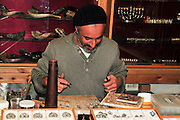 Israel, Upper Galilee, Tzfat, Jeweller at work in his workshop
