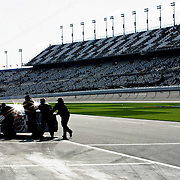 NASCAR Sprint Cup driver Travis Kvapil has his car pushed down pit row prior to the NASCAR Sprint Unlimited Race at Daytona International Speedway on Saturday, February 16, 2013 in Daytona Beach, Florida.  (AP Photo/Alex Menendez)