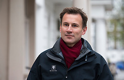 © Licensed to London News Pictures. File picture dated 28/04/2012.  Secretary of State for Culture, Olympics, Media and Sport JEREMY HUNT who is to be investigated by the Parliamentary Standards Commissioner over claims he failed to register donations from media firms, it has been announced. Pictured leaving his London home. Photo credit : Ben Cawthra/LNP