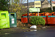 Rubbish bag dumped beneath No Fly Tipping sign, Sainsbury's recycling centre, Calne, England