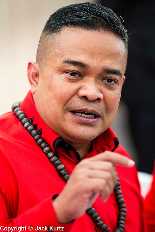 10 MAY 2014 - BANGKOK, THAILAND:  JUTAPORN PROMPAN, leader of the Red Shirts, speaks at a rally in Bangkok. Thousands of Thai Red Shirts, members of the United Front for Democracy Against Dictatorship (UDD), members of the ruling Pheu Thai party and supporters of the government of ousted Prime Minister Yingluck Shinawatra are rallying on Aksa Road in the Bangkok suburbs. The government was ousted by a court ruling earlier in the week that deposed Yingluck because the judges said she acted unconstitutionally in a personnel matter early in her administration. Thailand now has no functioning government. Red Shirt leaders said at the rally Saturday that any attempt to impose an unelected government on Thailand could spark a civil war. This is the third consecutive popularly elected UDD supported government ousted by the courts in less than 10 years.   PHOTO BY JACK KURTZ
