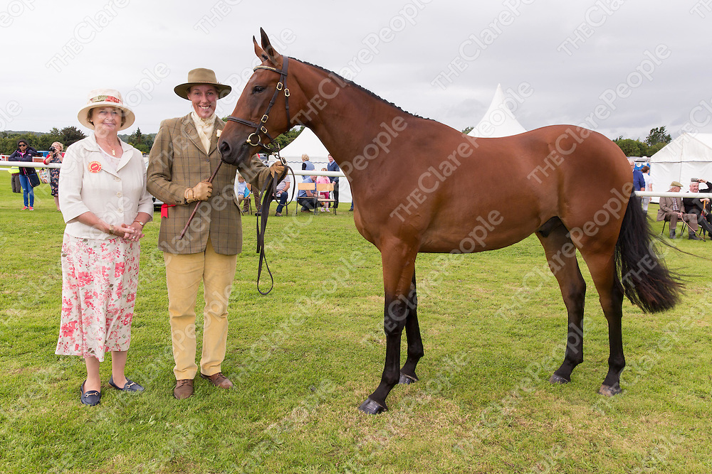 Judge Mrs Rachel Bennet with Rebecca Monahan from Tulla with Nota Marco, the prize winning 2 year old gelding