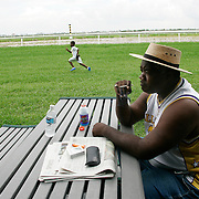 PALM BEACH, FLORIDA - September 5, 2005: ..Hurricane Katrina evacuee Kenneth Chaney  from New Orleans, Louisiana enjoys his first morning outside the ravaged New Orleans at the complex housing them in Palm Beach, Florida on Sept 5, 2005. (Photo by Todd Bigelow/Aurora)