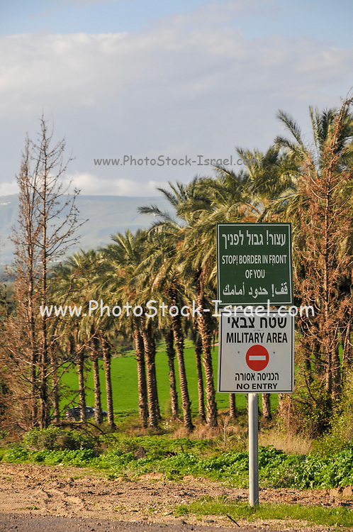 Stop, Border In Front of You. A warning sign in Hebrew Arabic and English. Photographed in The Golan Heights, Israel