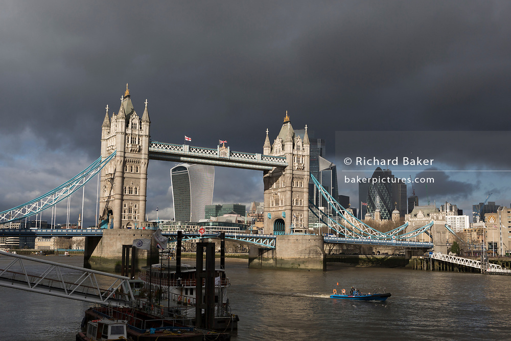 Weeks before the UK's Brexit from the European Union (on 31st January 2020), a wide cityscape of Tower Bridge and the City of London, the capital's financial district, all under a darkening sky, on 17th January 2020, in London, England.