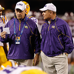 Jan 7, 2011; Arlington, TX, USA; LSU Tigers head coach Les Miles and offensive coordinator Gary Crowton talk during warm ups prior to kickoff of the 2011 Cotton Bowl against the Texas A&M Aggies at Cowboys Stadium. LSU defeated Texas A&M 41-24.  Mandatory Credit: Derick E. Hingle