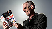 Tuesday 20th October 2015, Aberdeen, Scotland. Long-time presenter of BBC Radio Scotland's Sportsound and a life-long Aberdeen FC fan Richard Gordon with his new book Tales from the Dugout. <br /> Pictured: Richard at Pittdorie<br /> (Photo:Ross Johnston/Newsline Media)