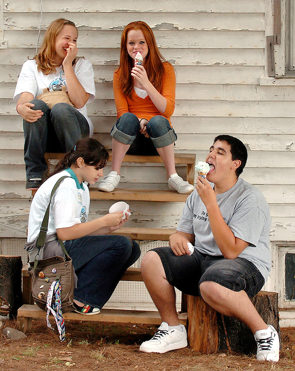 Megan Hysler, top left, Karter Kaplin, top right, Alida Lamagna, bottom left, and Connor Blake, bottom right, all of Suffield enjoy some ice cream at the 4th annual Farm Fest at Hilltop Farm in Suffield, Conn.
