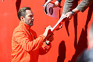 Jason McAteer of Liverpool legends team signs autographs prior to kick off. Liverpool Legends  v Real Madrid Legends, Charity match for the LFC Foundation at the Anfield stadium in Liverpool, Merseyside on Saturday 25th March 2017.<br /> pic by Chris Stading, Andrew Orchard sports photography.