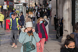 © Licensed to London News Pictures.15/12/2020, London, UK. Christmas shoppers at Oxford Street, before London will go into Tier 3 tomorrow. Photo credit: Marcin Nowak/LNP
