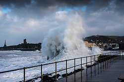 © London News Pictures. 02/03/2017. Aberystwyth, UK.<br /> After a night of gale force winds, thunderstorms and hailstones,  the mornings 5.4m high spring tide bring large  waves to batter the promenade and sea defences in Aberystwyth on the Cardigan Bay coast of West Wales. Photo credit: Keith Morris/LNP