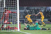 Jordan Green of Newport County scores his teams second goal, 2-1,  during the The FA Cup match between Newport County and Alfreton Town at Rodney Parade, Newport, Wales on 15 November 2016. Photo by Andrew Lewis.