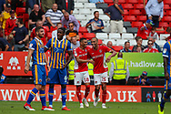 Goalscorer Charlton Athletic forward Karlan Ahearne-Grant (18) celebrates with teammate midfielder Darren Pratley (15) taking the score to 2-1 to Charlton during the EFL Sky Bet League 1 match between Charlton Athletic and Shrewsbury Town at The Valley, London, England on 11 August 2018.