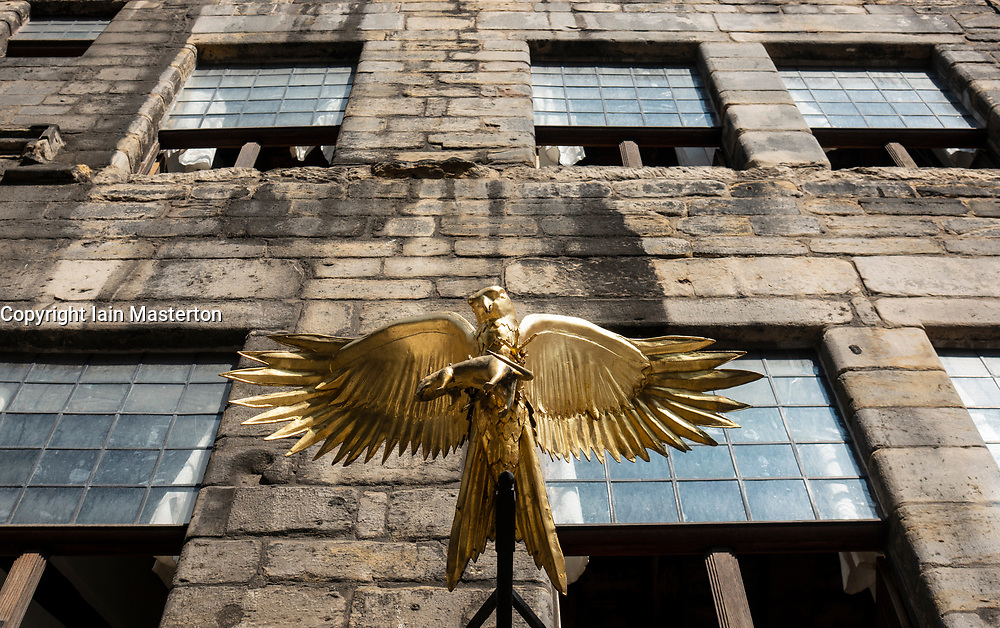 Golden bird outside Gladstones Land historic building on Royal Mile in Old Town of Edinburgh, Scotland, Uk