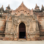 BAGAN, Myanmar - BAGAN, MYANMAR--Dating to the reign of Narathihapate (1256-1287), Tayok Pye Temple is located on the eastern side of the plain of Bagan near Minnanthu. Of particular note are intricate renovated stucco work and decorative paintings on the interior walls. It is also one of the handful of temples that are open to climbing onto upper terraces.