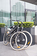 Two bicycles outside The Maker Hotel at the Grand Canal Quay on 06th April 2017 in Dublin, Republic of Ireland. Dublin is the largest city and capital of the Republic of Ireland.
