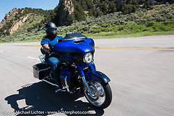 Michael Pulliam of Chula Vista, CA on his 2017 CVO Street Glide riding from Steamboat Springs to Doc Holliday's Harley-Davidson in Glenwood Springs during the Rocky Mountain Regional HOG Rally, Colorado, USA. Thursday June 8, 2017. Photography ©2017 Michael Lichter.