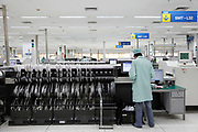 Workers operate on a communications equipment assembly line at a ZTE Corporations factory in Shenzhen, Guangdong Province, China on 17 November 2009.  ZTE is a rapidly expanding global provider of telecommunications equipment and network solutions.