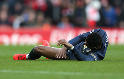 Manchester United's Marcus Rashford lays on the floor injured