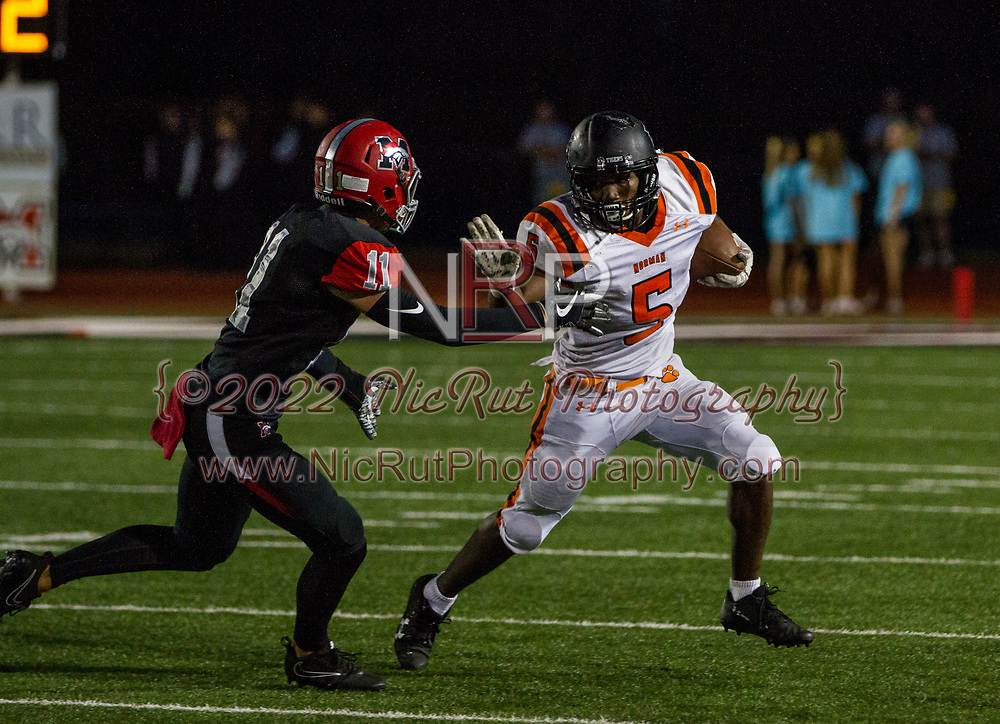 Traevon Edmundson (#5) running for more yards with a stiff arm against the Broncos defense.