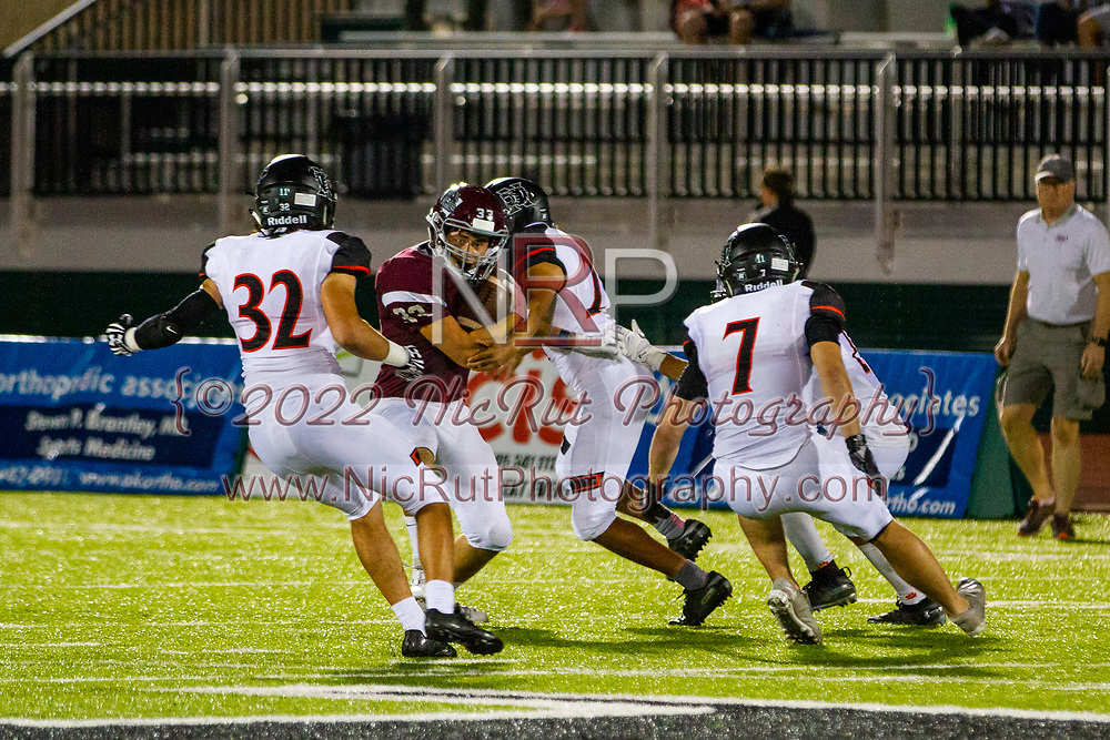 Edmond's Cade Adams is tackled by Norman's Jaedan Ford during the game in Edmond on Friday, October 05, 2018.