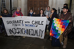 London, UK. 6 December, 2019. Activists from groups including the Campaign Against Climate Change, the Chilean Assembly in London, Medact, Biofuelwatch and UK Student Climate Network hold a vigil outside the Chilean embassy in solidarity with the people of Chile following the transfer of UN climate negotiations from Santiago to Madrid with the consequent effect of marginalising the voices of activists and communities from the Global South.