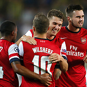 Arsenal's players  celebrate goal during the UEFA Champions League Play-Offs First leg soccer match Fenerbahce between Arsenal at Sukru Saracaoglu stadium in Istanbul Turkey on Wednesday 21 August 2013. Photo by /TURKPIX