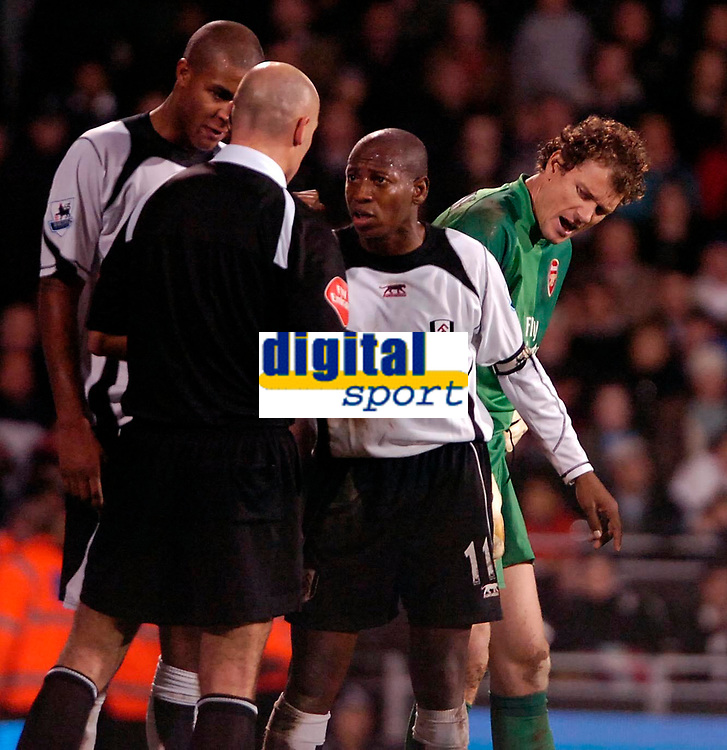 Photo: Ed Godden.<br /> Fulham v Arsenal. The Barclays Premiership. 29/11/2006.<br /> Fulham's Luis Boa Morte has words with Referee Mr Howard Webb.